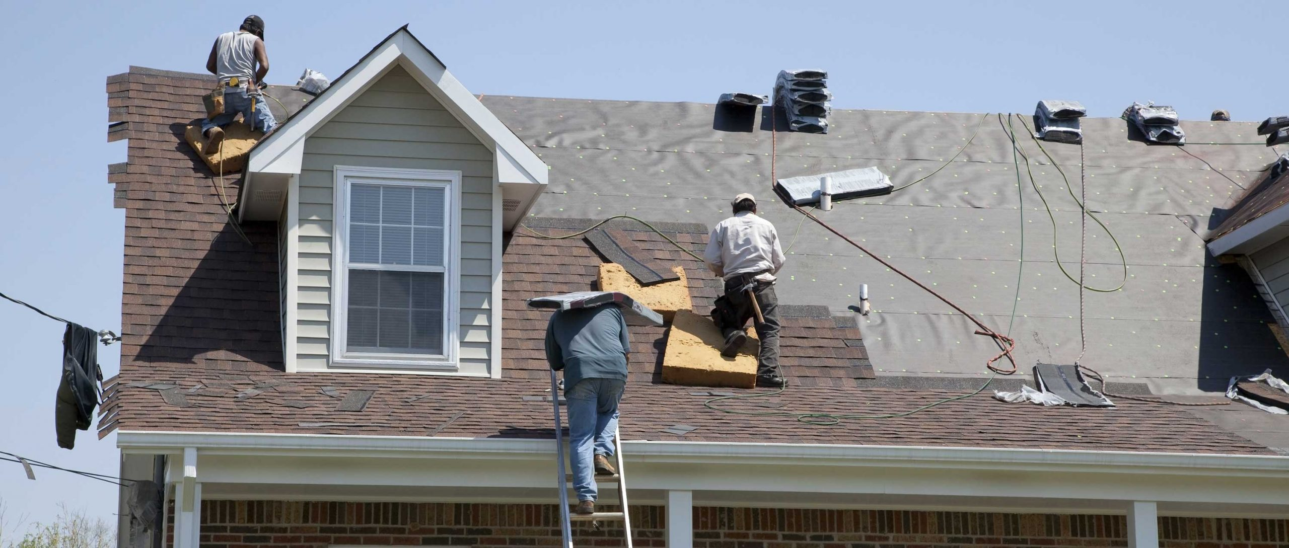 roofing workers repairing roof