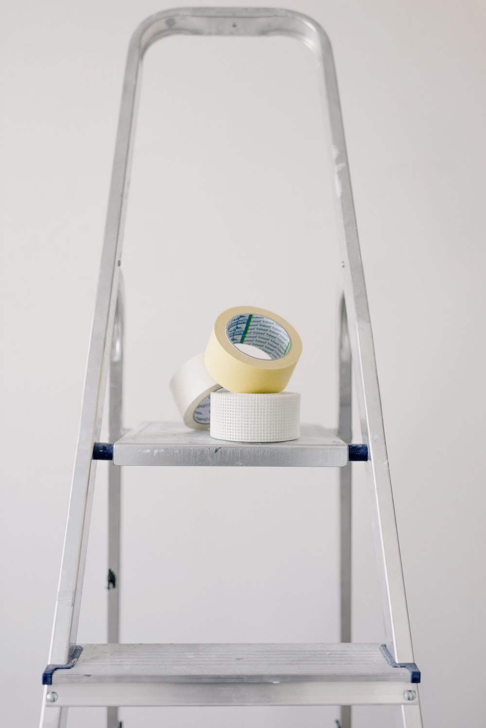 The equipment of a water damage contractor sits on a stool.